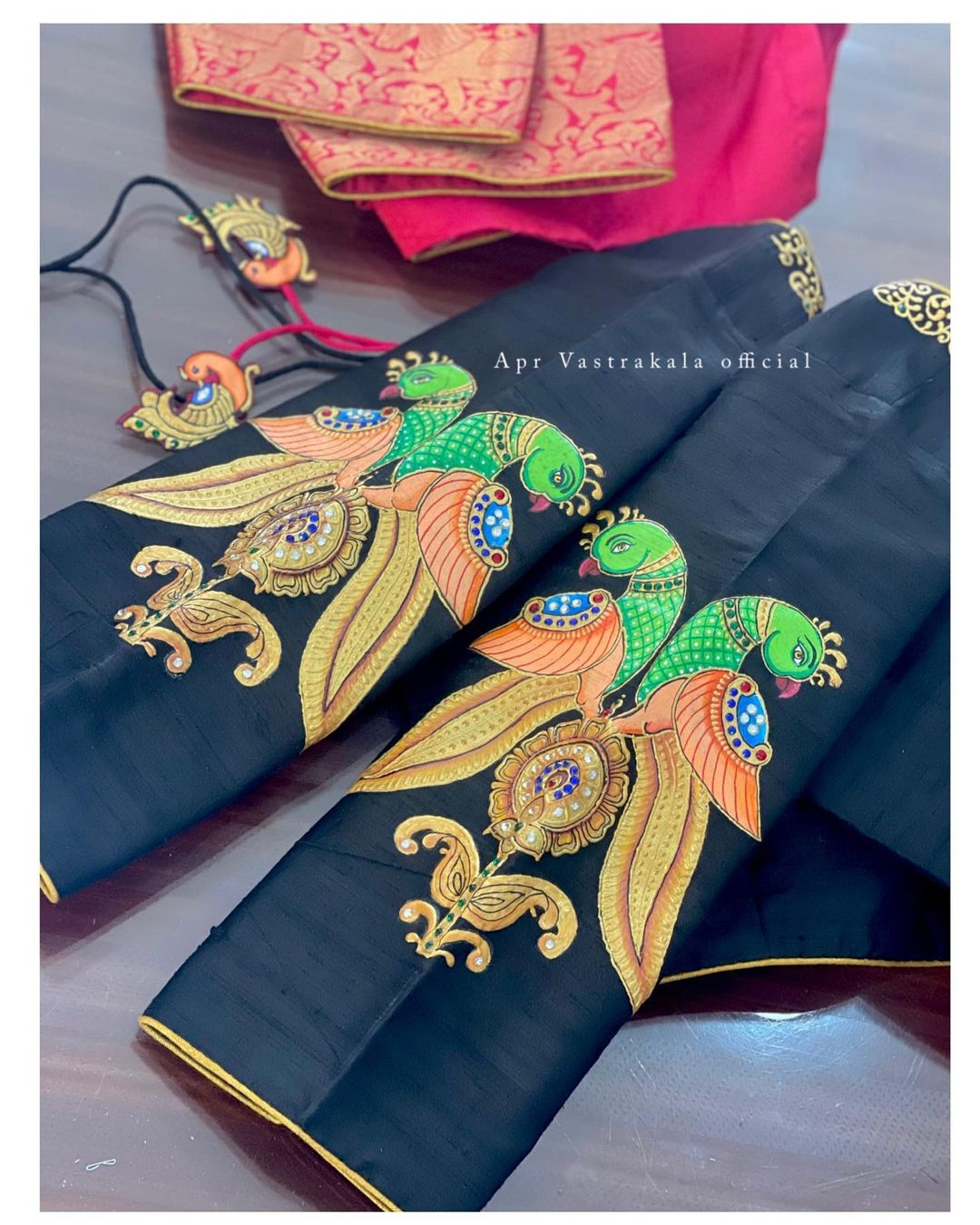 Gorgeous bridal blouse sleeves with parrots tanjore painting hand embroidery blouse. 2021-10-09