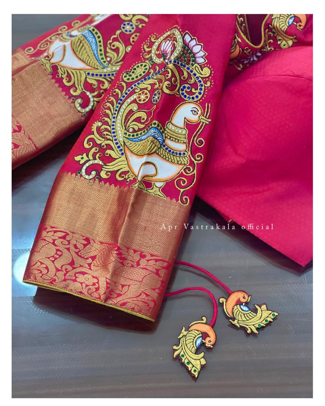 Gorgeous bridal blouse sleeves with peacock tanjore painting hand embroidery blouse. 2021-10-09