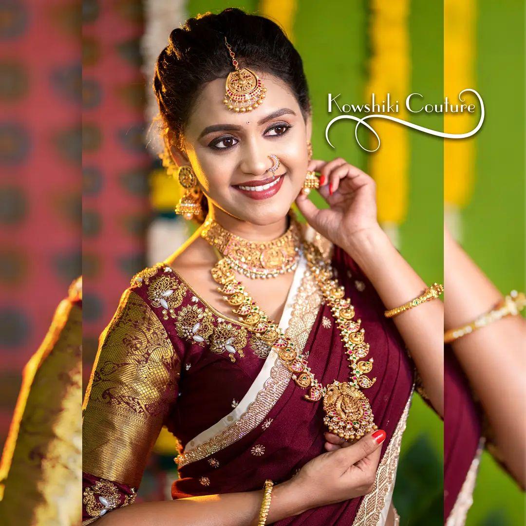 Actres Sowjanya looks ravishing in pure banarasi silk half saree adorned with kanchi pattu border. 2021-10-09