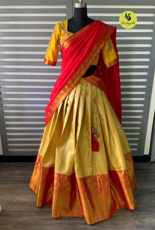 Stunning gold shade pattu lehenga and yellow blouse with red pattu dupatta. 2021-10-10