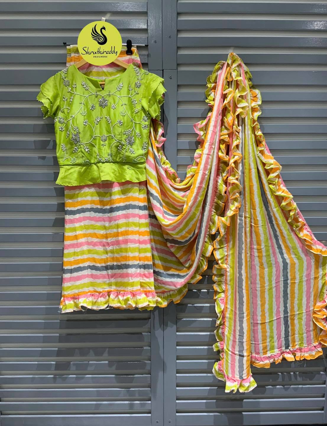 Gorgeous multi color striped saree and hand embroidery work parrot green crop top.  2021-10-10