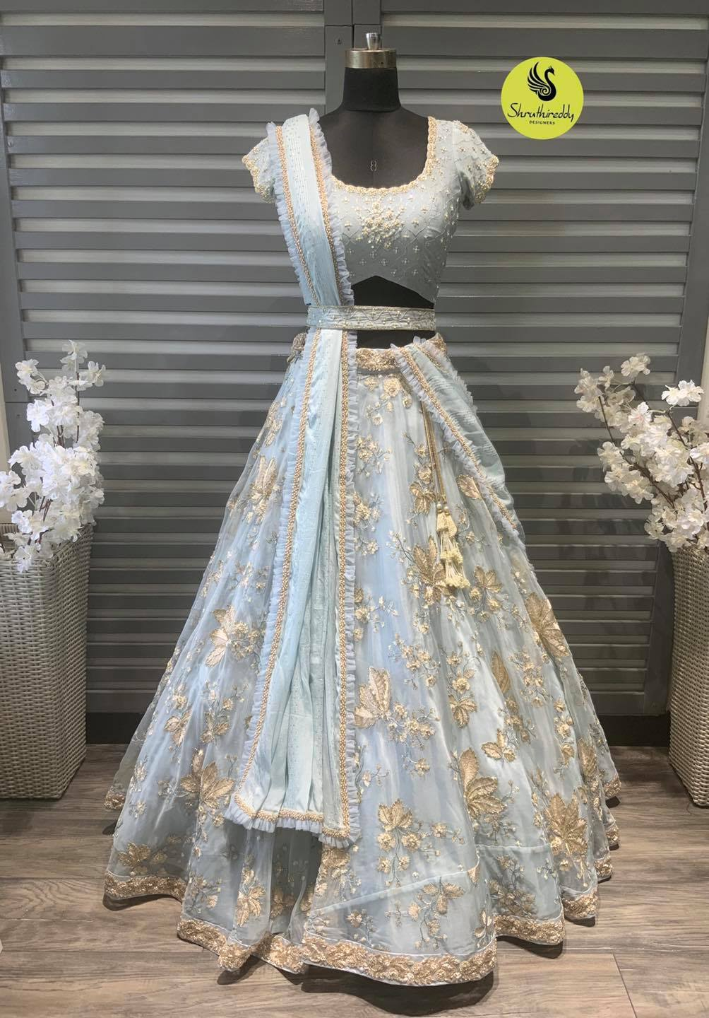 Beautiful ice blue color net or tulle net bridal lehenga and blouse with net dupatta.  2021-10-10