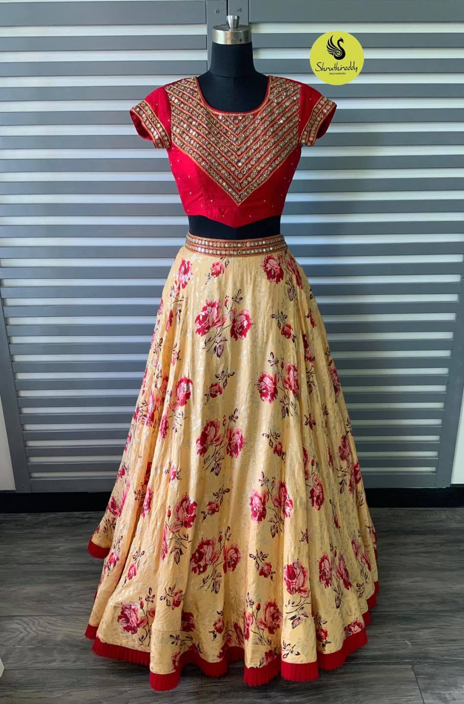 Beautiful floral skirt and red color yoke embroidery crop top.   2021-10-10