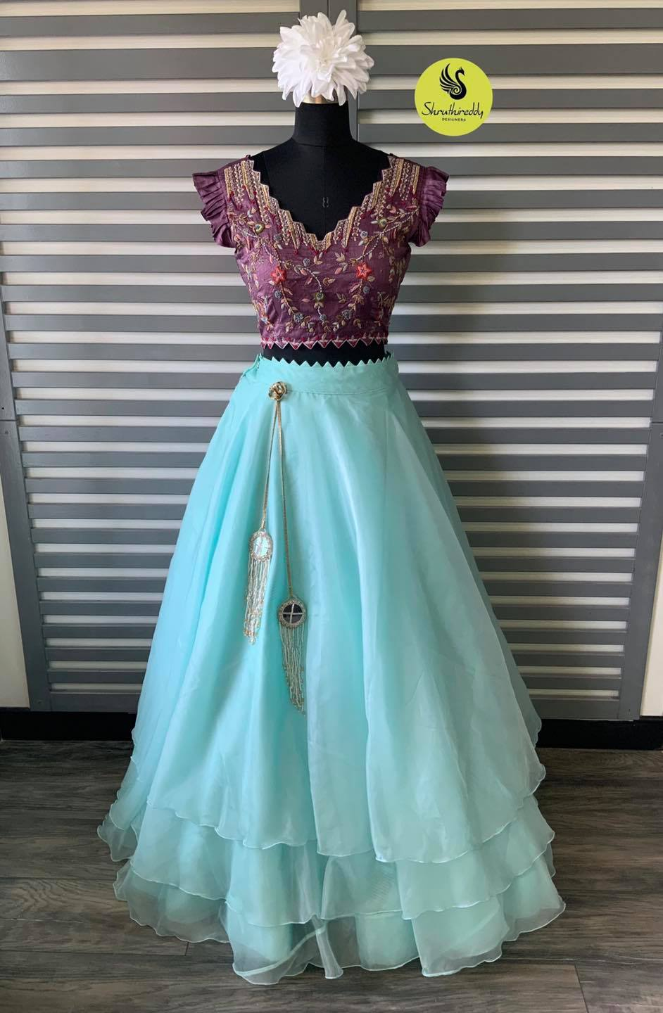 Gorgeous sea green color net leyered skirt and purple color embroidery crop top.  2021-10-10