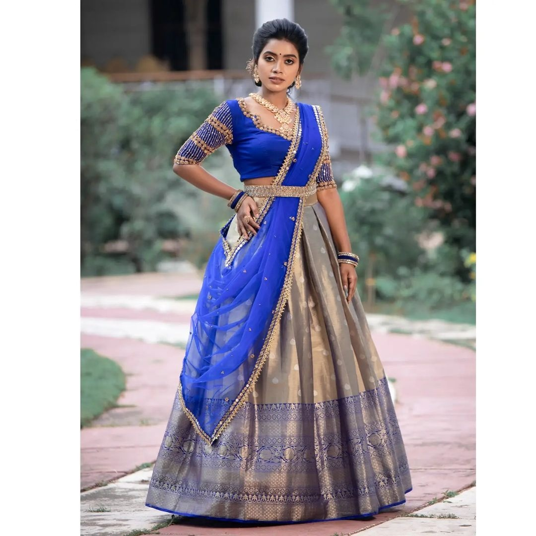 Bridal half saree. . . ✨ Beautiful Metallic pleated skirt with vibrant blue blouse and net dupatta  ✨ . . Place your orders now!  . . For orders and queries please whatsapp  on  9952093562 or Reach  on 044 4262 4085. 2021-10-10