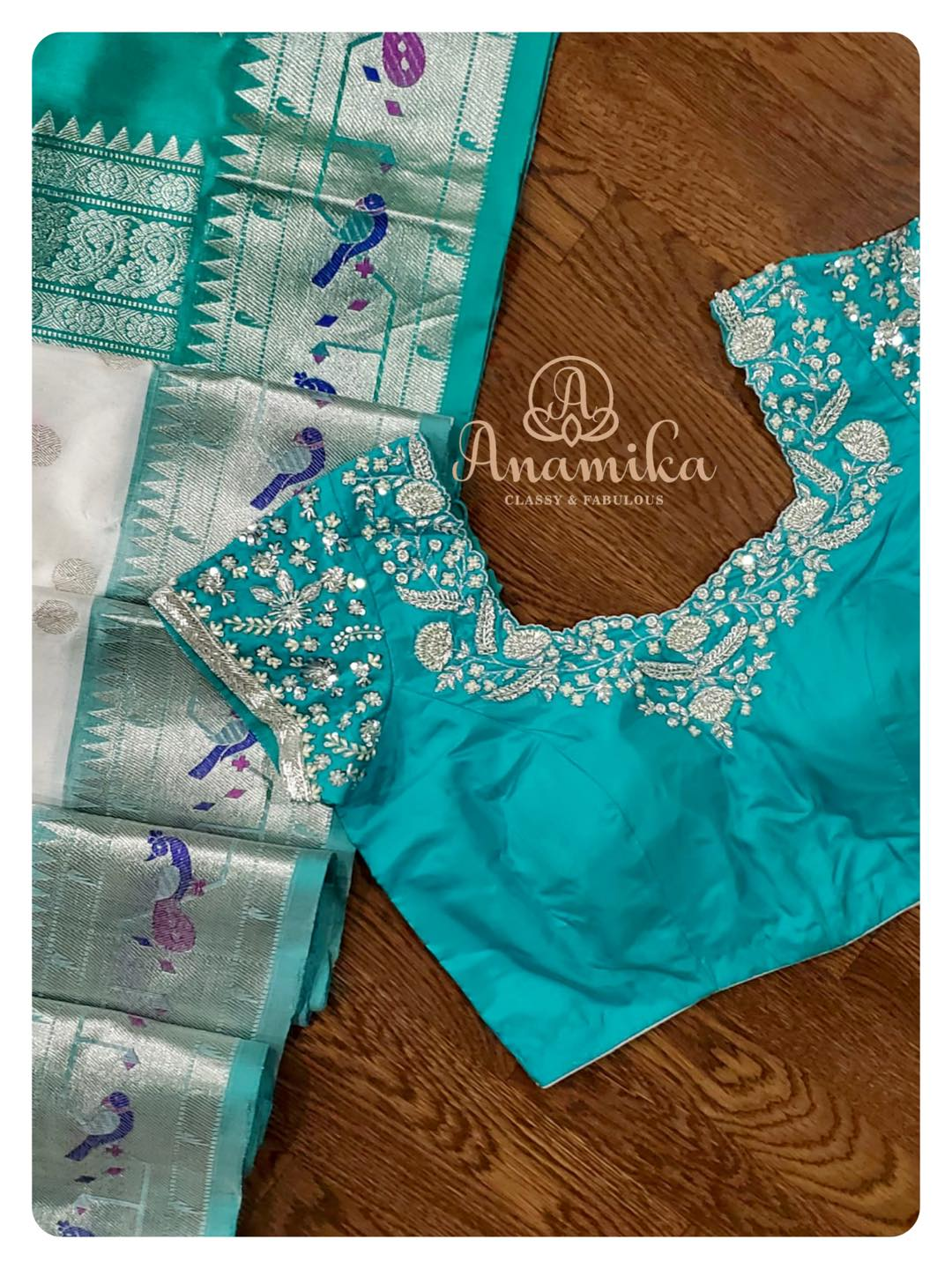 Let's try something unique in a silk saree ...  A white venkatagiri pattu saree with polka dots and a woven paithani border is so unique and classy.. that its sure to grab your attention !  Paired with a contrast teal green blouse with silver work ... this is something different!