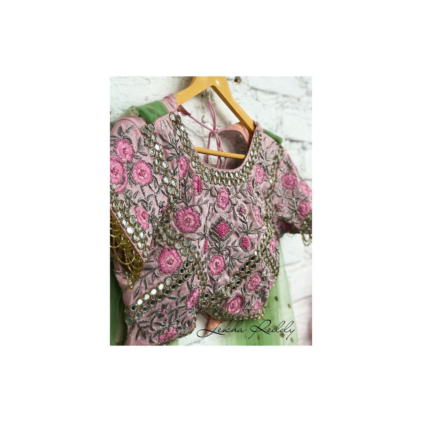 Mirror embellished blouse…!! Gorgeous blush pink color blouse with floral hand embroidery thread and mirror work.  2021-10-11