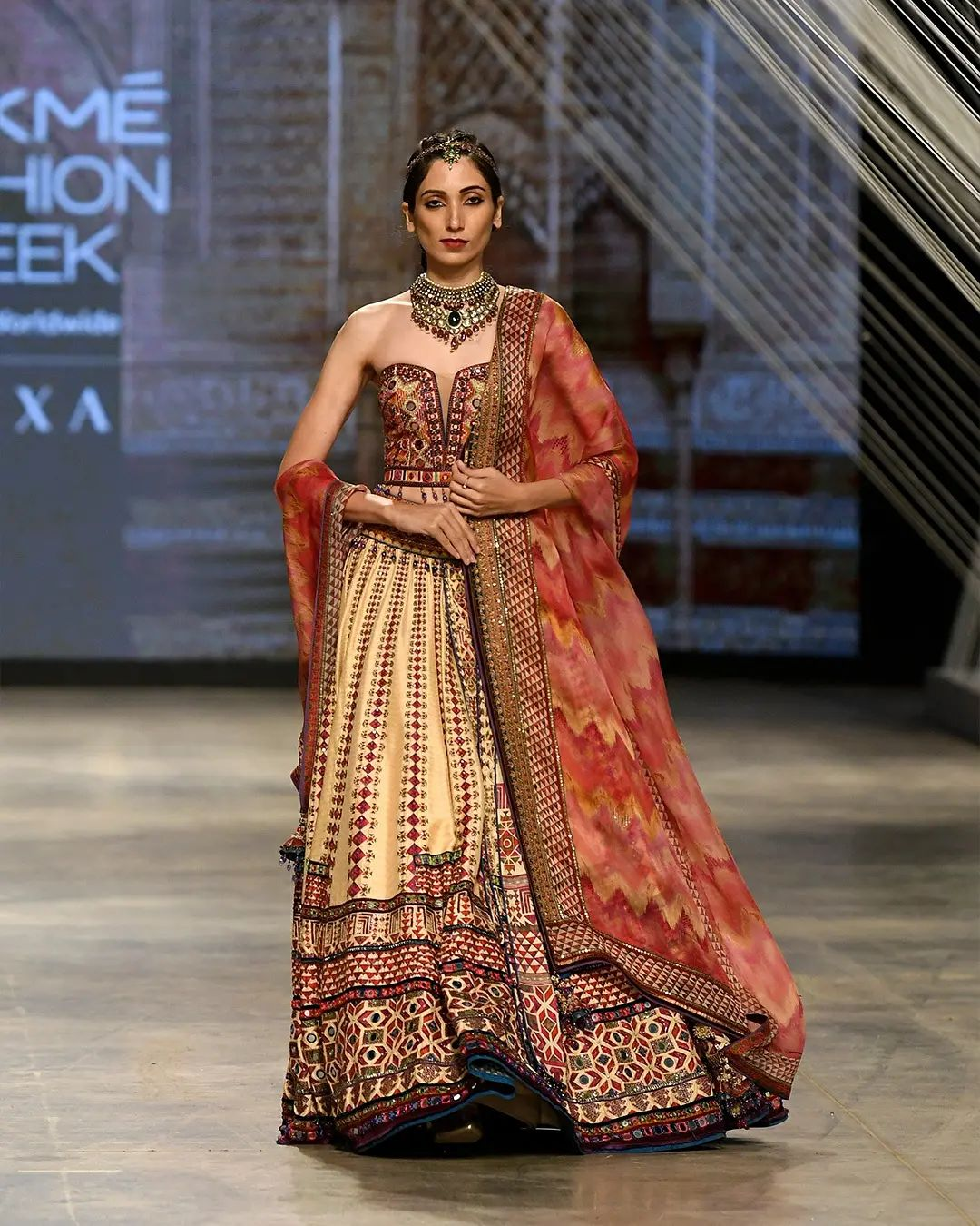 Tarun Tahiliani lehenga set. The on-ground episode of FDCI x Lakmé Fashion Week unfolded with Autumn/Winter 2021 collection on 7th of October. They presented  ten diverse signature capsule lines. 2021-10-11