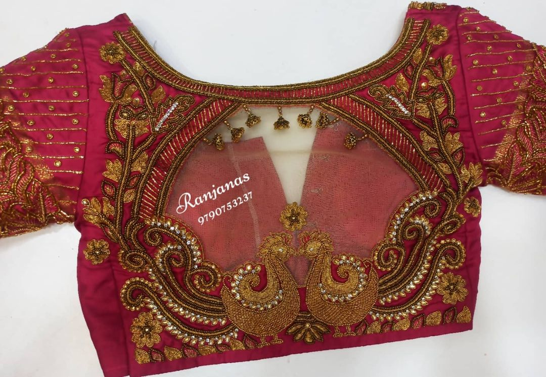 Stunning bridal blouse with floral creeper and peacock hand embroidery bead and kundan aari work.  2021-10-11