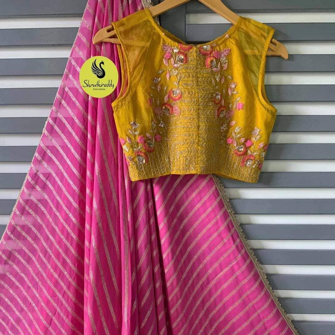 Stunning pink leheriya saree and mustard yellow crop top. Crop top with floral thread maggam work. 2021-10-11