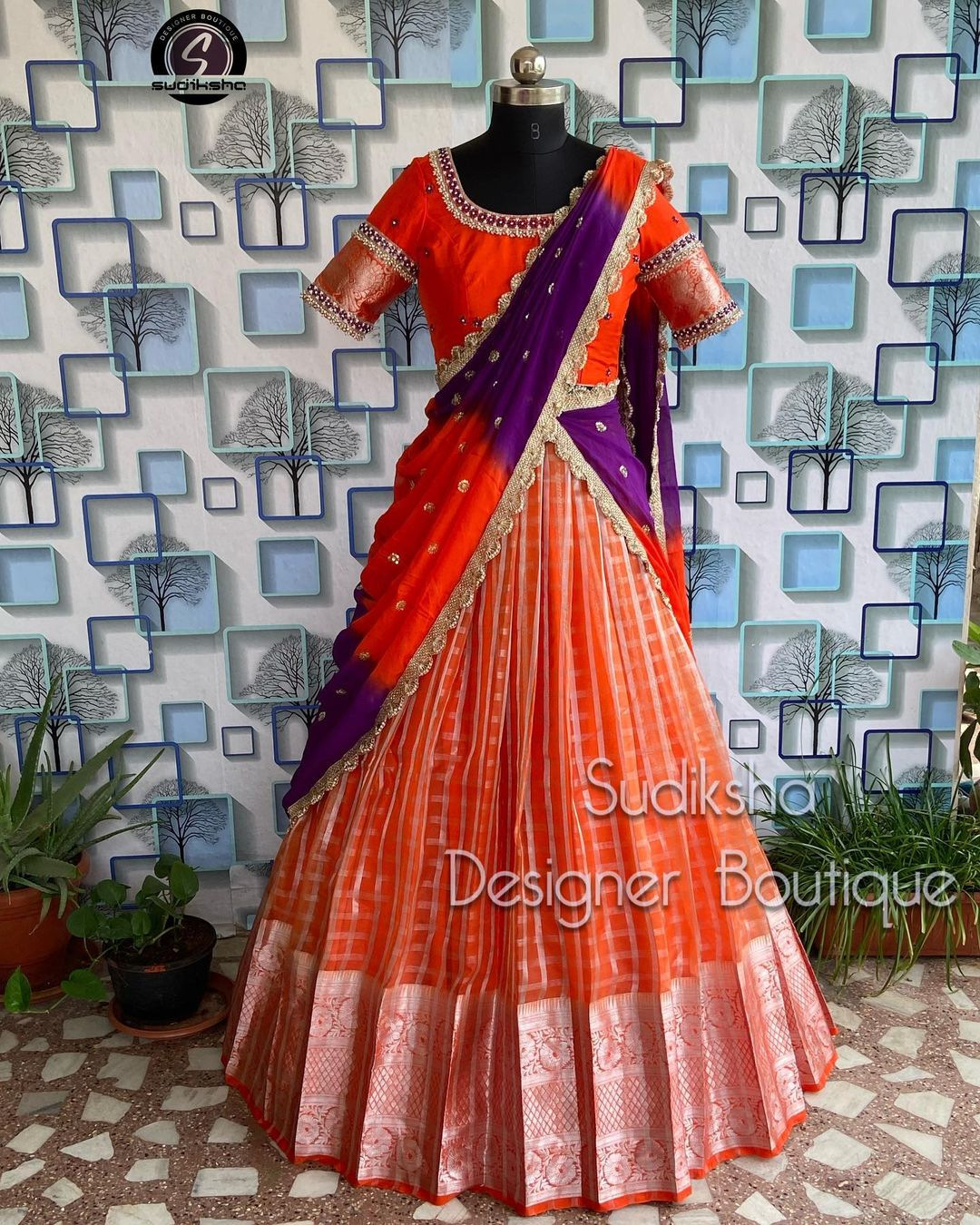Stunning brick red checked silver pattu lehenga and blouse with net dupatta. Blouse with hand embroidery work.  2021-10-11