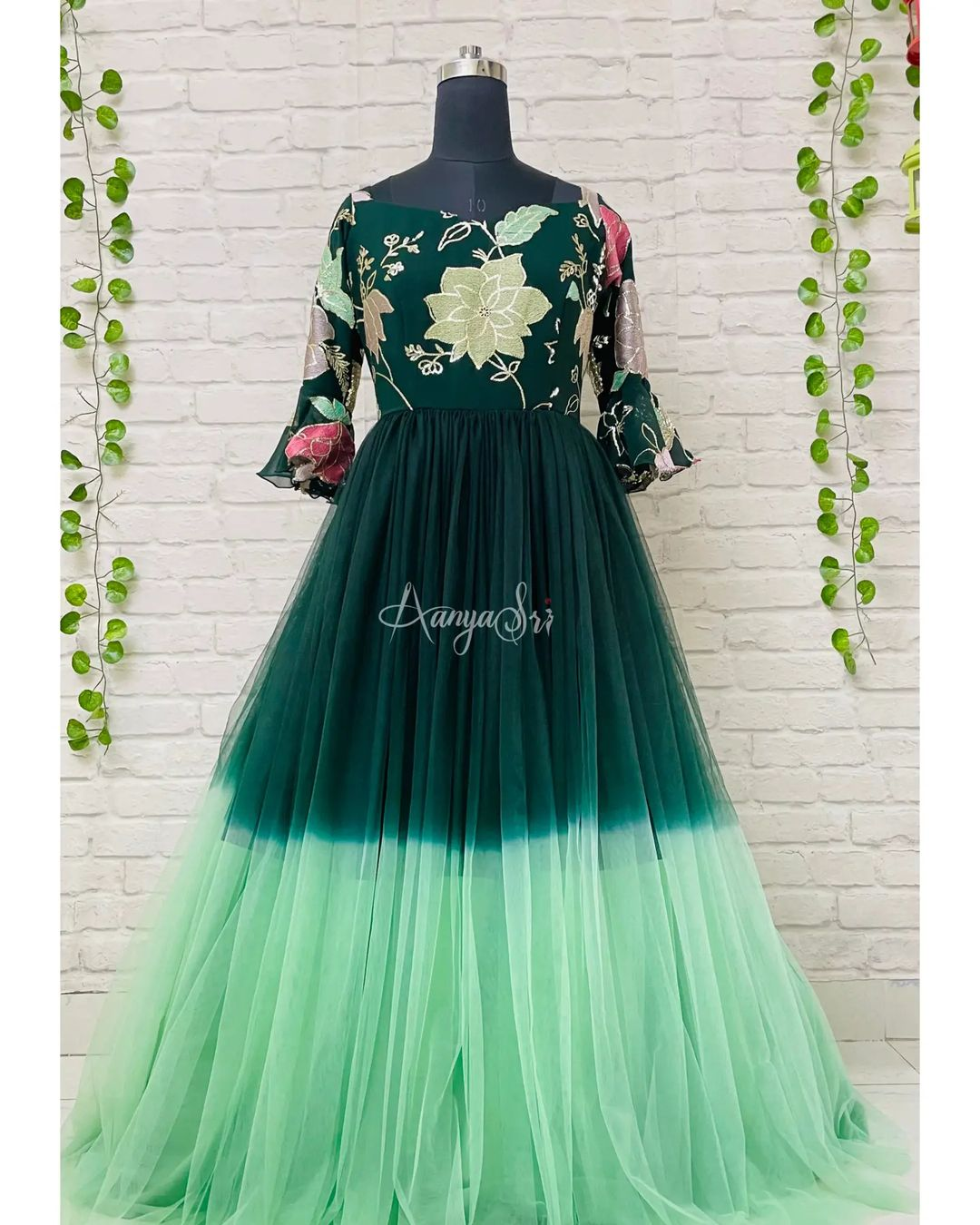 Beautiful green floral ombre long frock with machine embroidered detailing for the yoke and dual shade net for the flare. Comes along with bell sleeves ( If you need full sleeves or short sleeves you can mention the same in comments while placing an order ). Price : RS. 5500. 2021-10-11