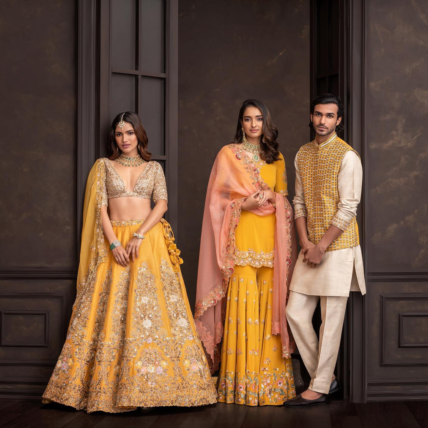 Gorgeous sunshine yellow color bridal lehenga set with resham hand embroidery work and sequin blouse with net dupatta.  2021-10-12