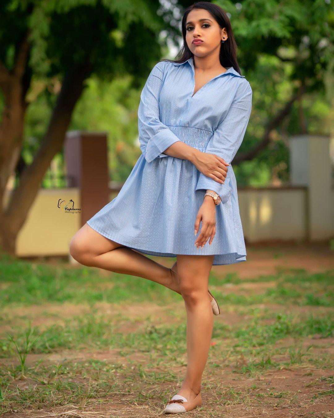 Stunning anchor Rashmi Gautham in sky blue color knee length shirt dress. 2021-10-12