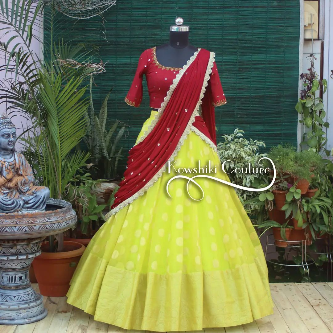 Gorgeous yellow color pattu lehenga and maroon blouse with dupatta. Blouse with embroidery work.   2021-10-12