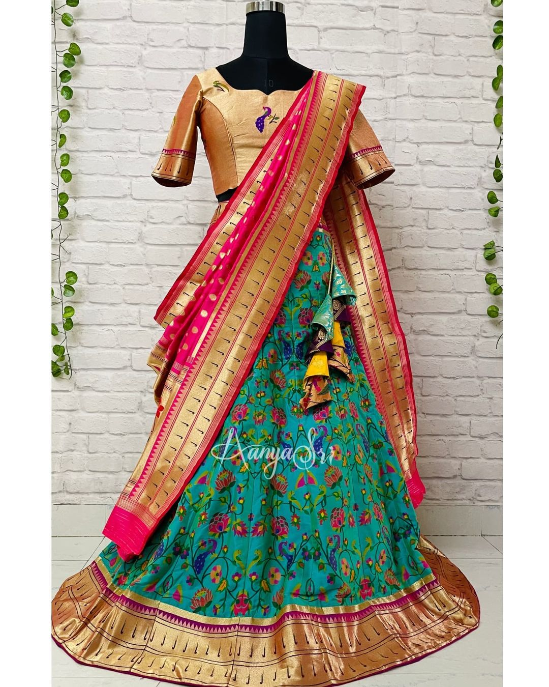 Teal colored traditional paithani lehenga with paithani gold blouse and pink paithani dupatta. This is perfect for weddings and looks grand & elegant !! Price : RS. 9400/-   2021-10-12