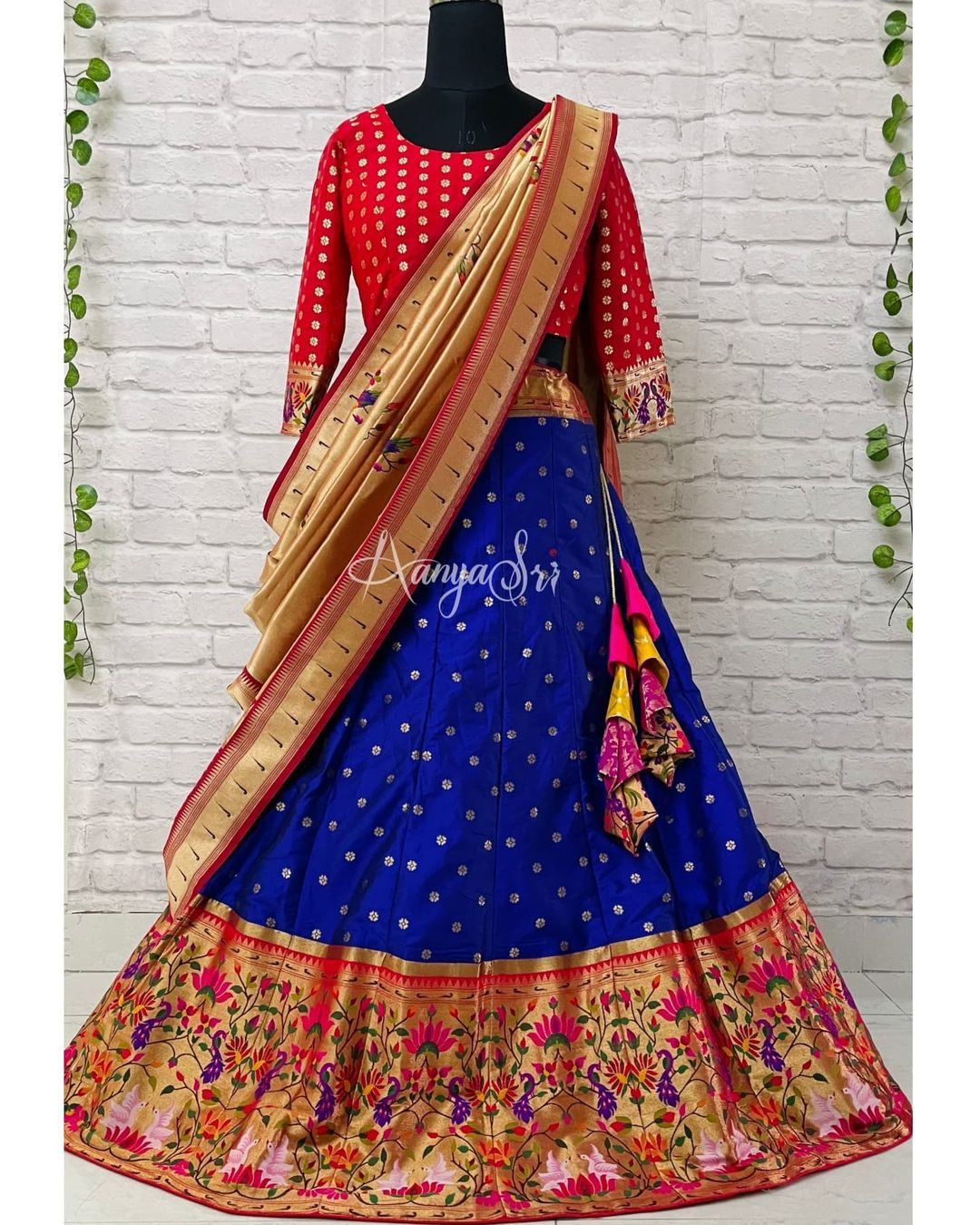 Blue traditional paithani lehenga with red blouse and gold paithani dupatta. This is perfect for weddings and looks grand & elegant !! 2021-10-12