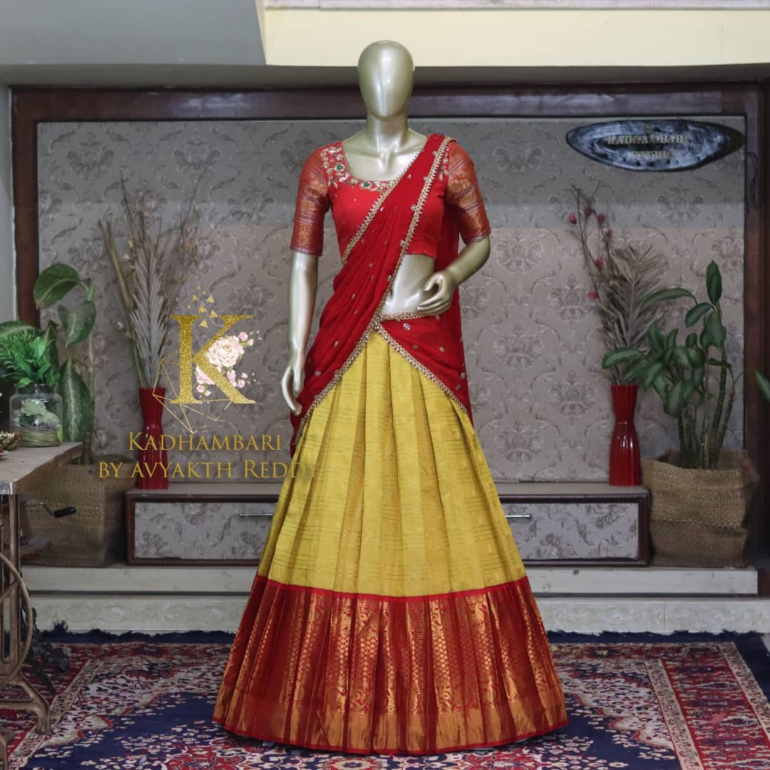Stunning mustard yellow and red color combination pattu langa voni. Blouse with maggam work.  2021-10-12