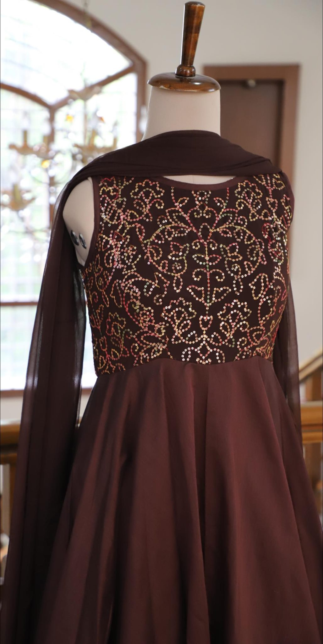 Stunning chocolate brown color long frock with hand embroidery yoke.   2021-10-13