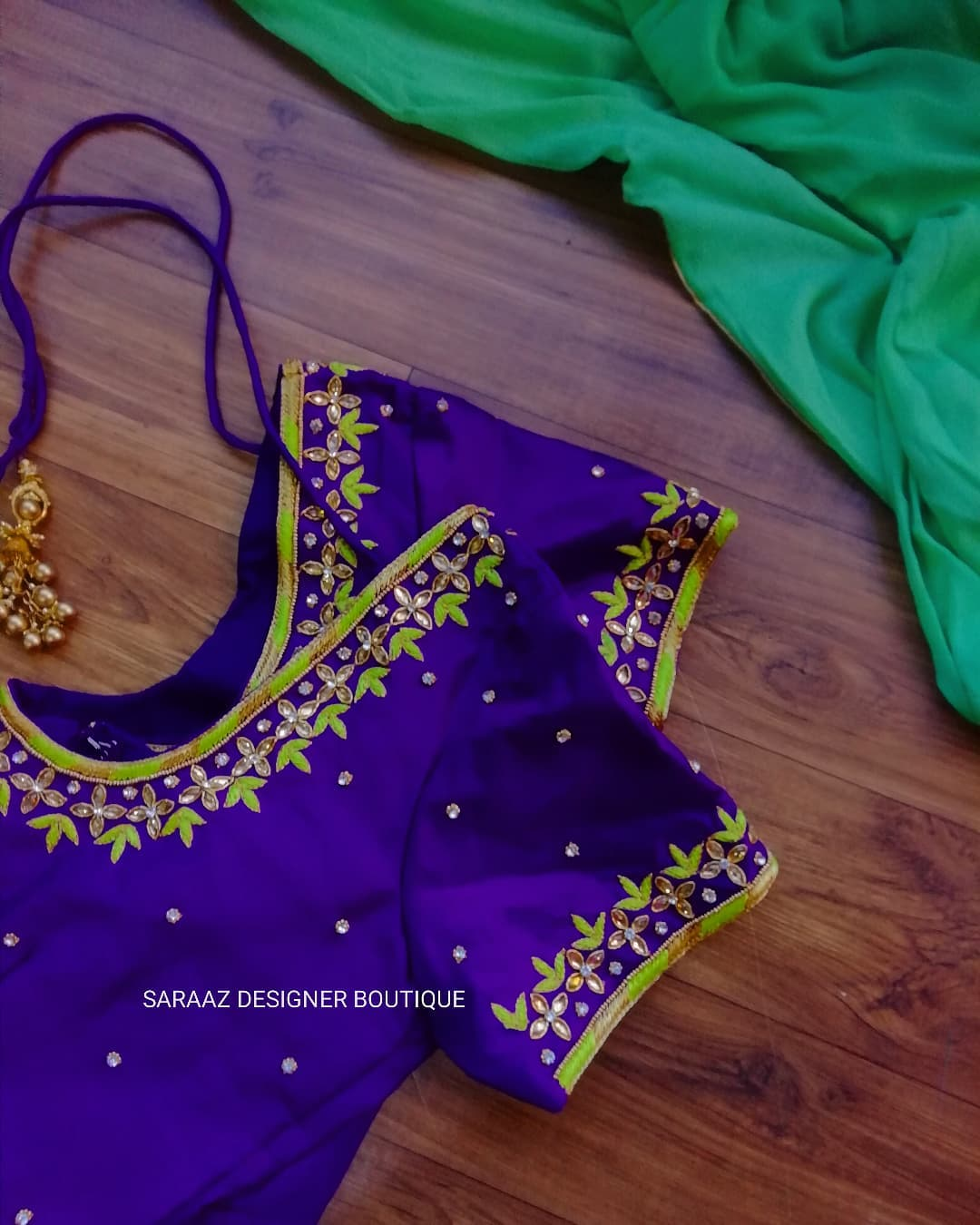 Gorgeous royal blue color blouse with thread and kundan simple aari work on neckline and sleeves. 2021-10-13