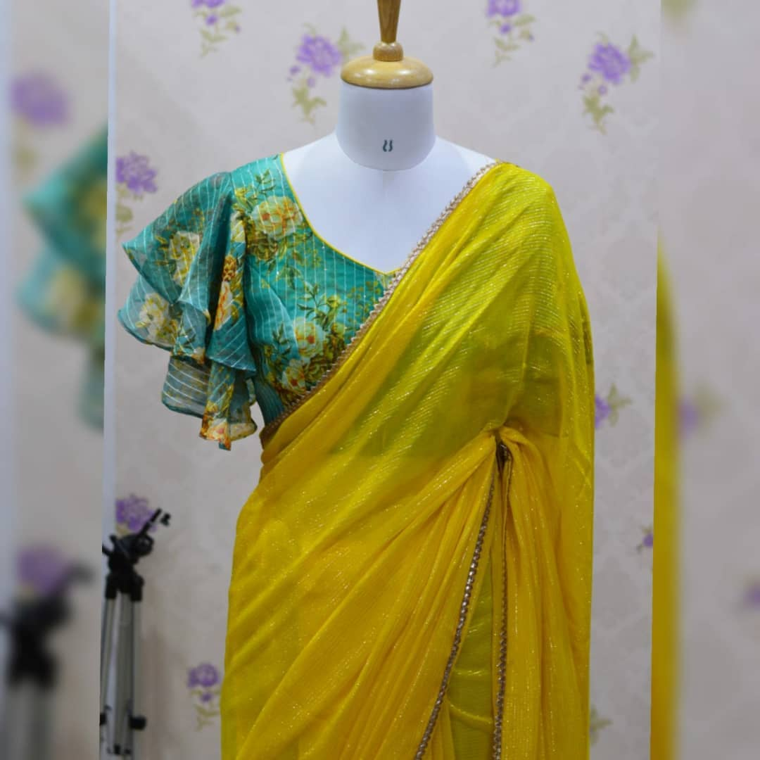 Awesome ...Beautiful mango yellow georgette saree paired up with nice Double layered bell sleeves blouse. Collection no;063SHV For price details inbox  or watsapp on +917799503713. 2021-10-14