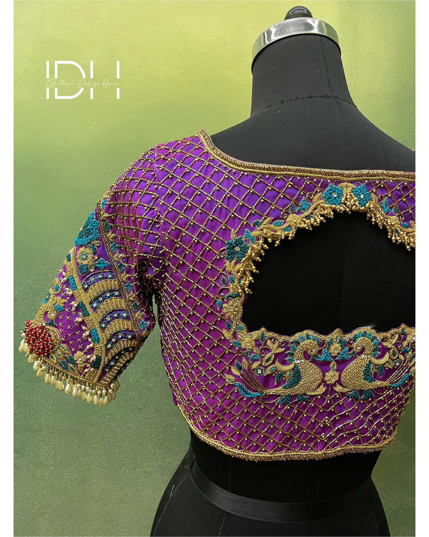 Heavily embellished bridal blouse. Gorgeous purple color bridal blouse with swans and floral bead zardosi work. 2021-10-14
