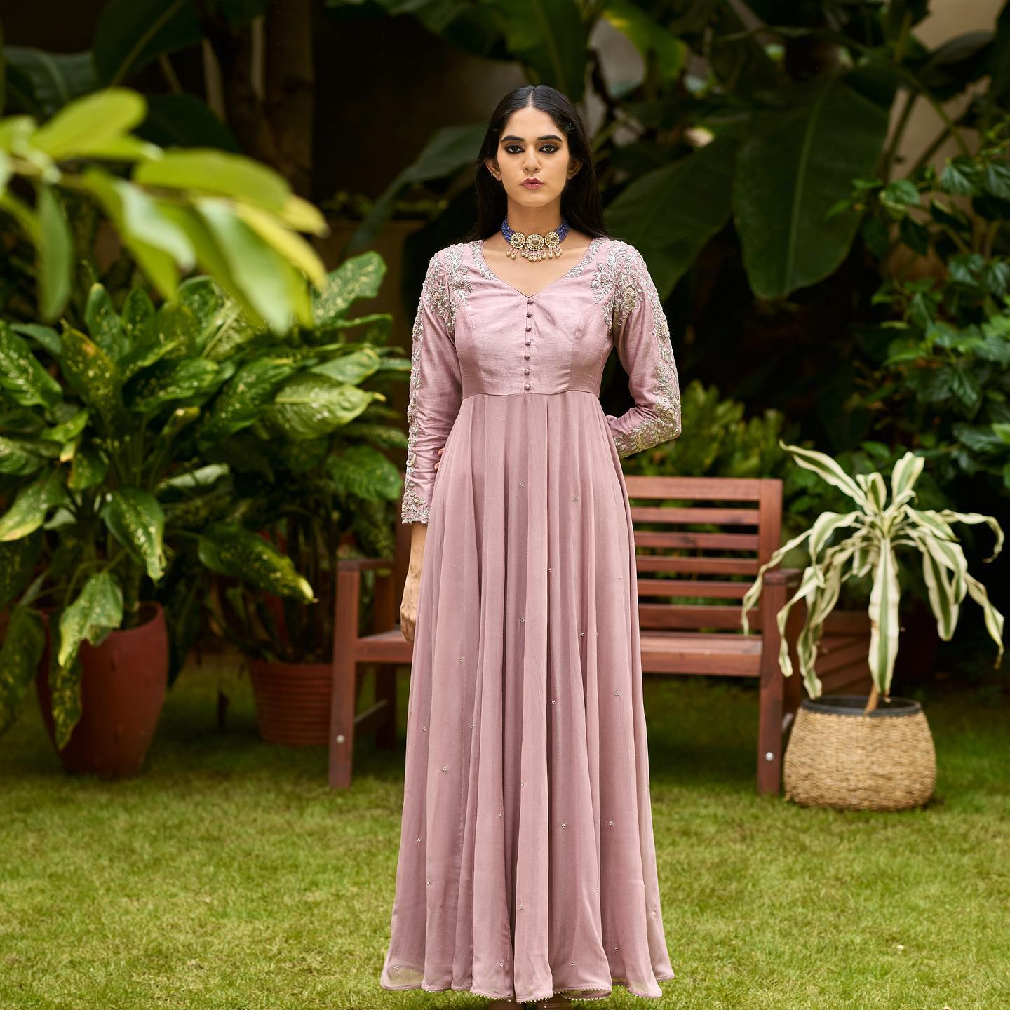 Phulwari . Kritya in Maple pink long anarkali. This garment features elegant zardozi embroidery on sleeves and shoulder with small detailing all over. The silhouette is classic and unique at the same time.  To shop our new collection Phulwari DM or Whatsapp on +91 99083 48333. 2021-10-14