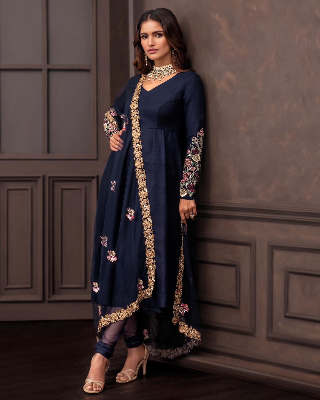 A Deep-blue matka silk kalidaar kurta with contrast resham embroidery. . Wedding Couture 21-22 Shyamal and Bhumika. 2021-10-14