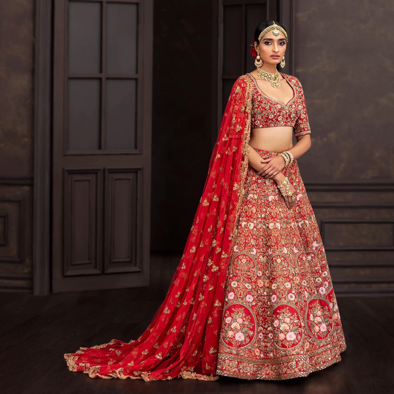 A classic deep-red raw silk lehenga with handcrafted zardosi and aari embroidery. . Wedding Couture 21-22 Shyamal & Bhumika 2021-10-14