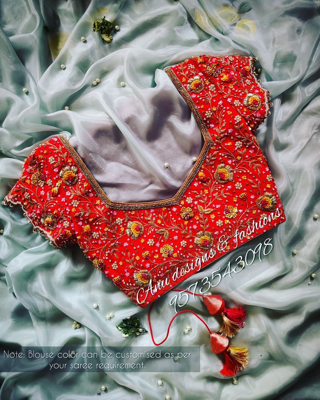 Stunning red color bridal blouse with floral and creeper maggam work. 2021-10-14