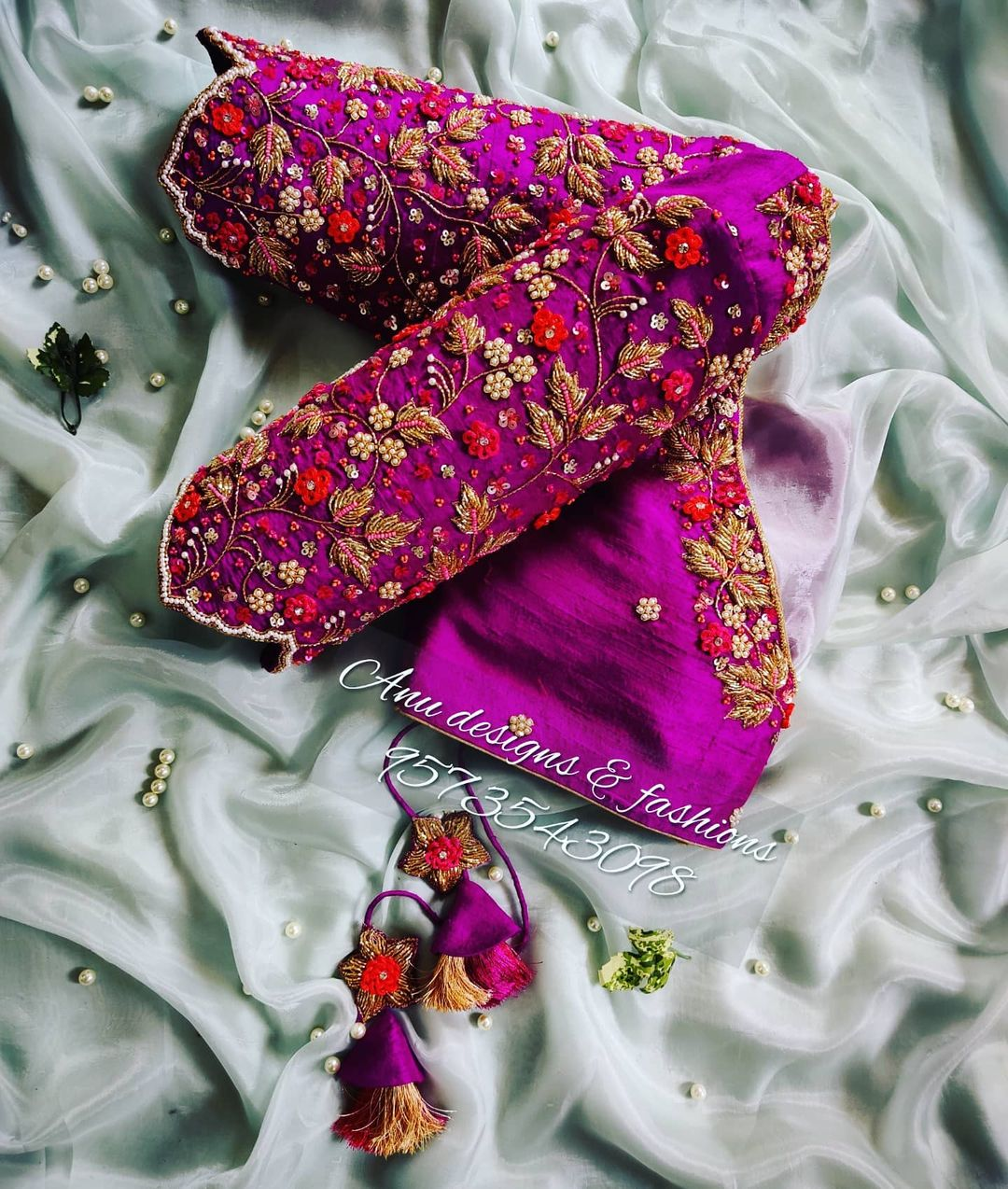 Stunning purple color bridal blouse with floral and creeper maggam work. 2021-10-14