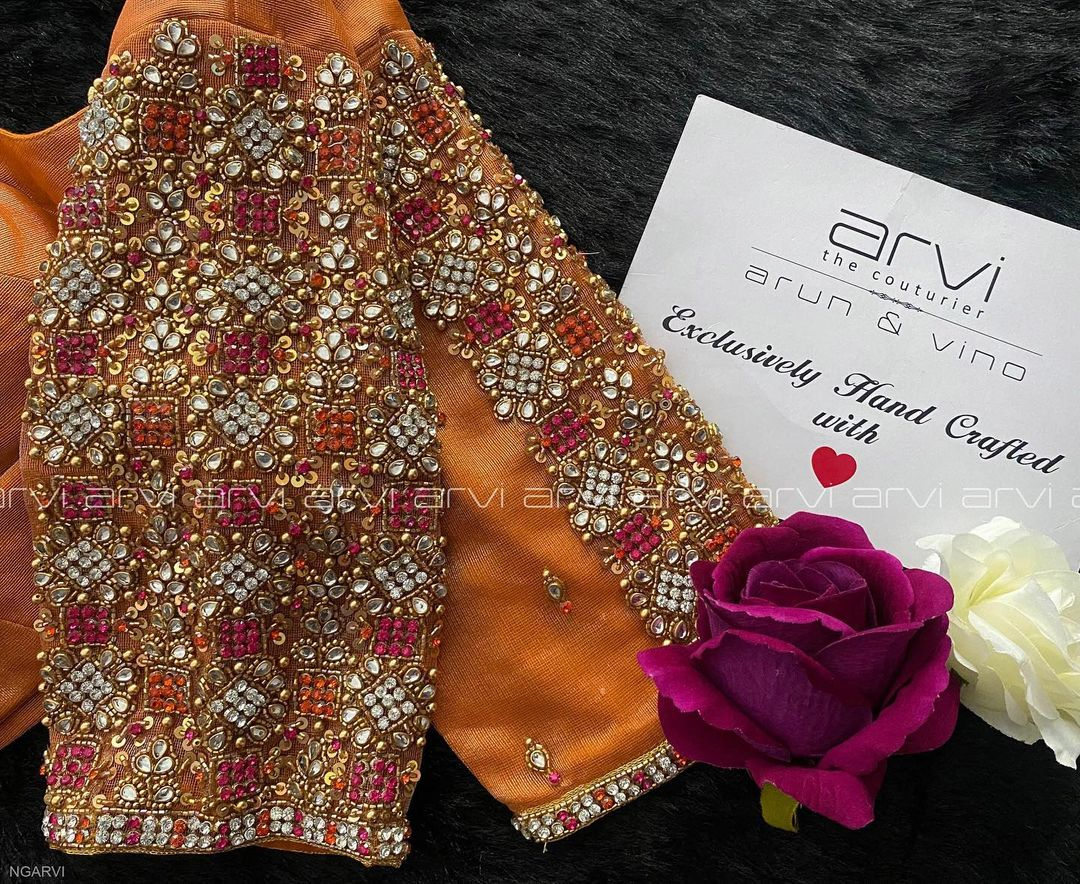 Gorgeous bridal blouse with stone aari work on neckline and sleeves. 2021-10-14