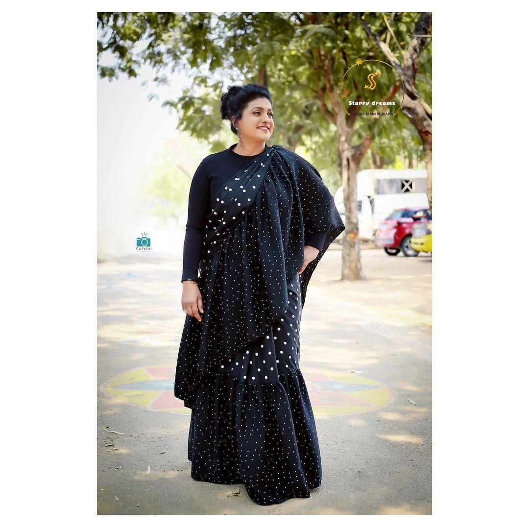 Gorgeous actress Roja Sevamani in black color mirror work ruffle saree. 2021-10-14