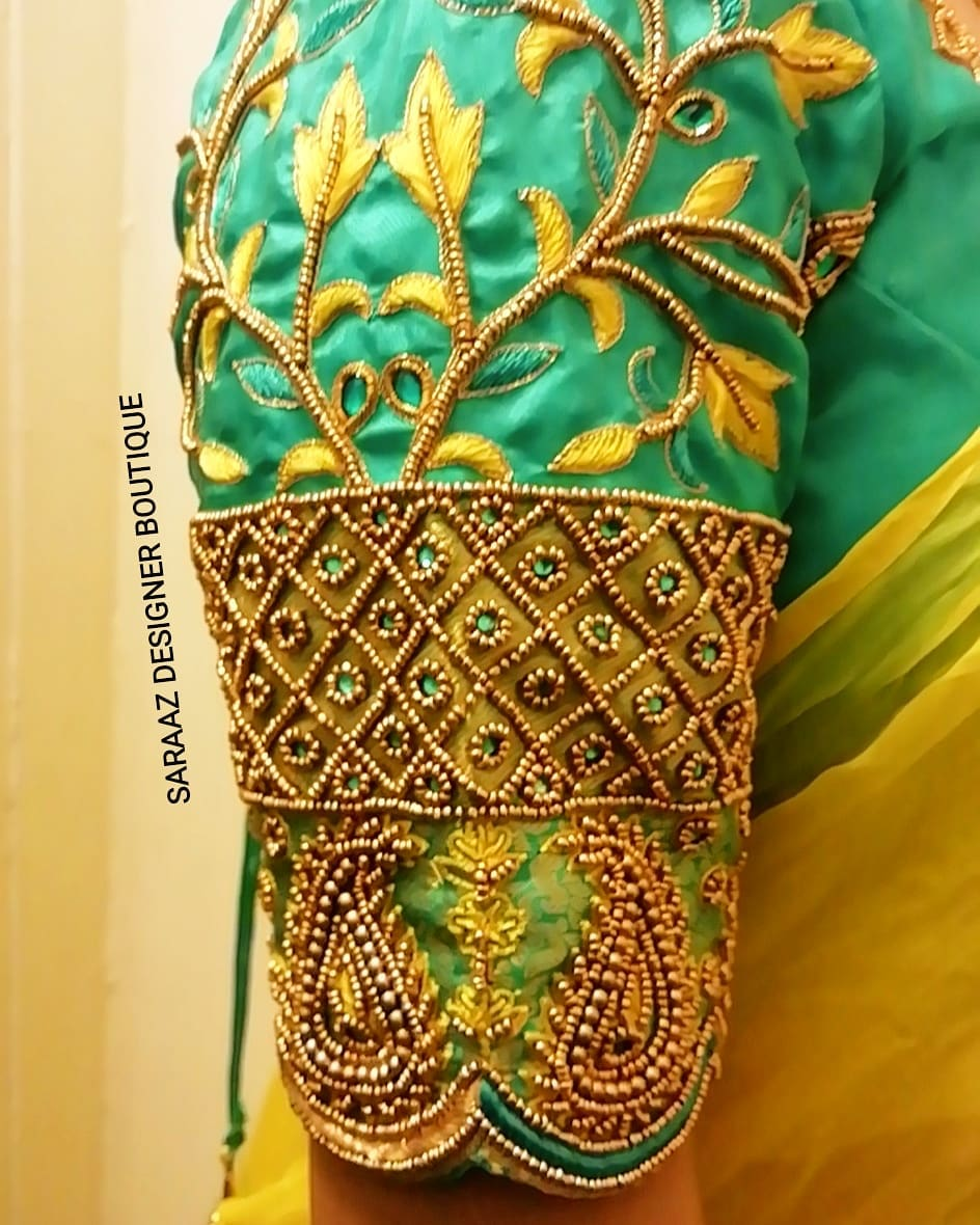 Gorgeous green color bridal blouse sleeve with floral and creeper bead aari work. 2021-10-14