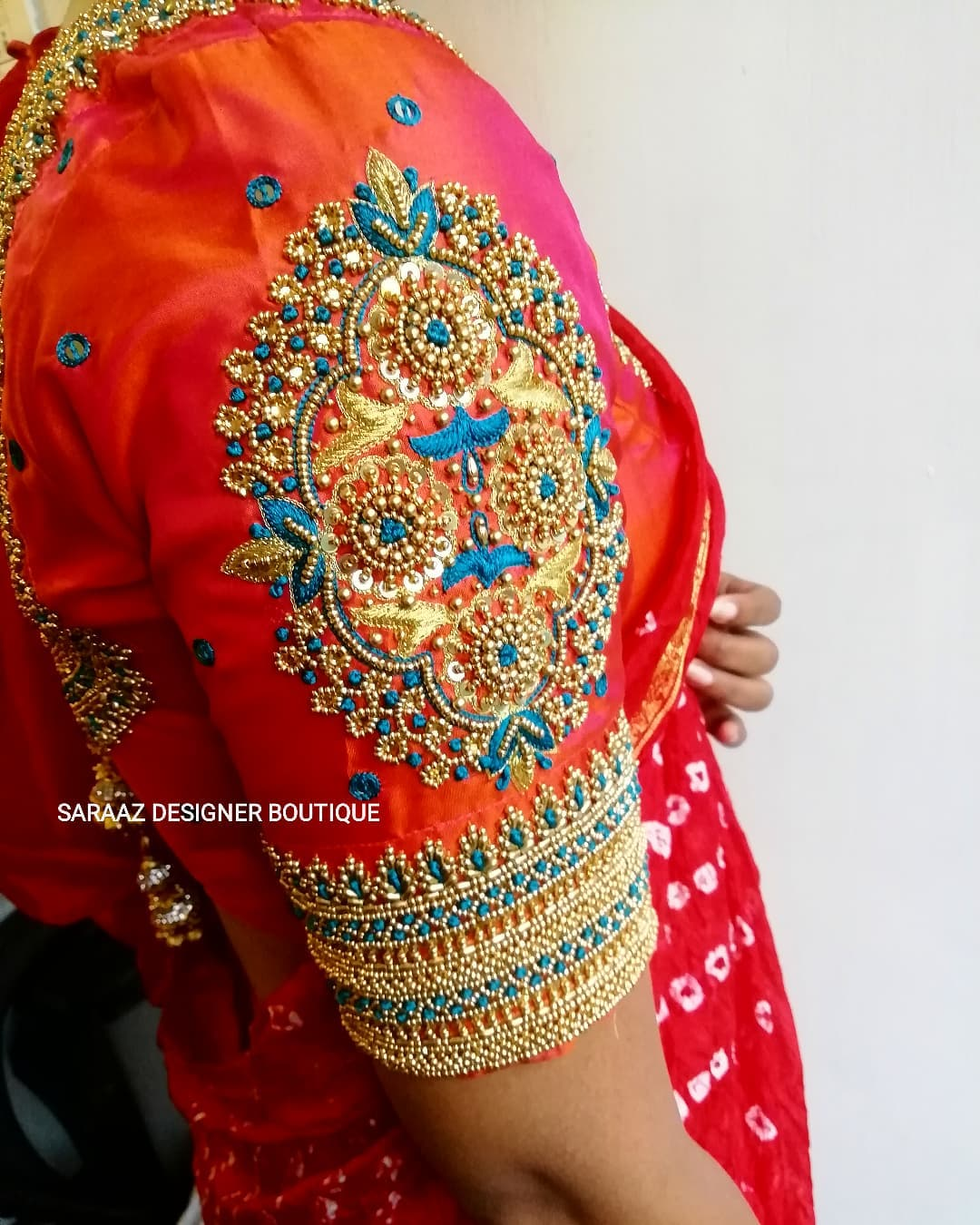 Gorgeous red color bridal blouse sleeve with bead and thread zardosi work. 2021-10-14
