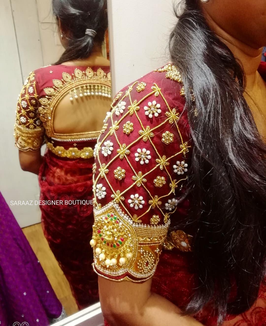 Stunning maroon color bridal blouse sleeve with bead aari work on neckline and sleeves. 2021-10-14