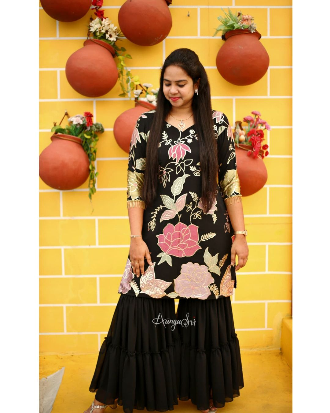 Beautiful black floral 3 piece sharara set with machine embroidered detailing for the Kurta and 2 layered detailing for the sharara . Comes along with hangings detailing for the hands and a black matching dupatta. Price : RS. 4900/- 2021-10-14
