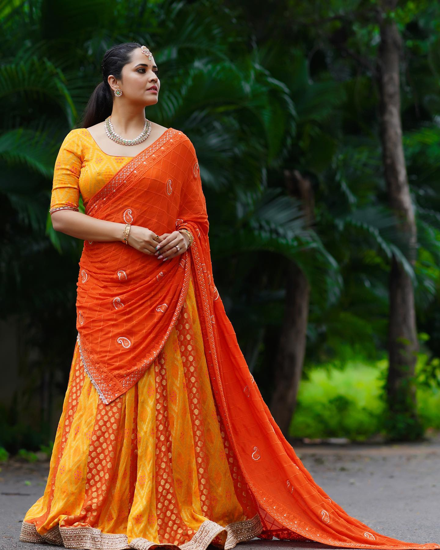Beautiful actress and anchor Anasuya Bardwaj in yellow and orange color combination halfsaree. Outfit and Styling by Gauri Naidu. 2021-10-15
