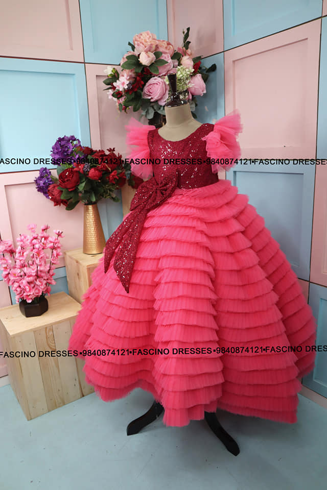 A classy pink with maroon sequin ruffle kids gown beauty from Fascino for a little princess . Wats app or inbox to order 9840874121. Can customize in any color / size. 2021-10-15