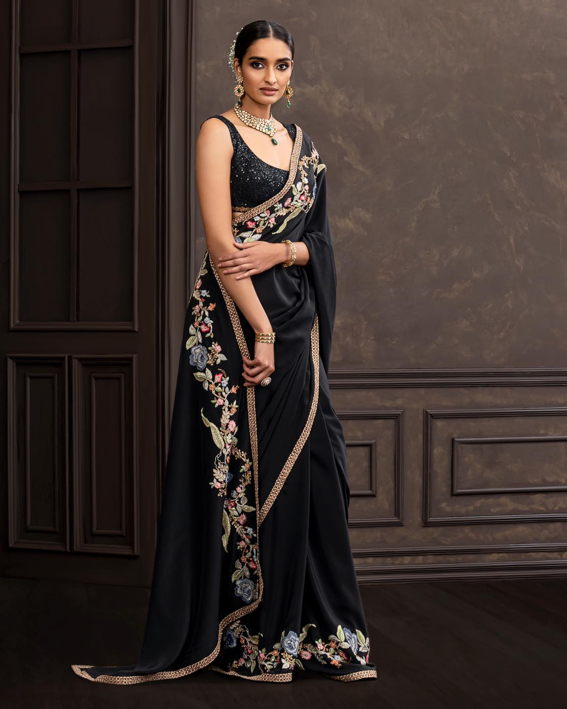 A beautiful black crepe-silk floating border saree. . Wedding Couture 21-22 Shyamal and Bhumika . Discover the latest Wedding Couture Collection 2021-10-15