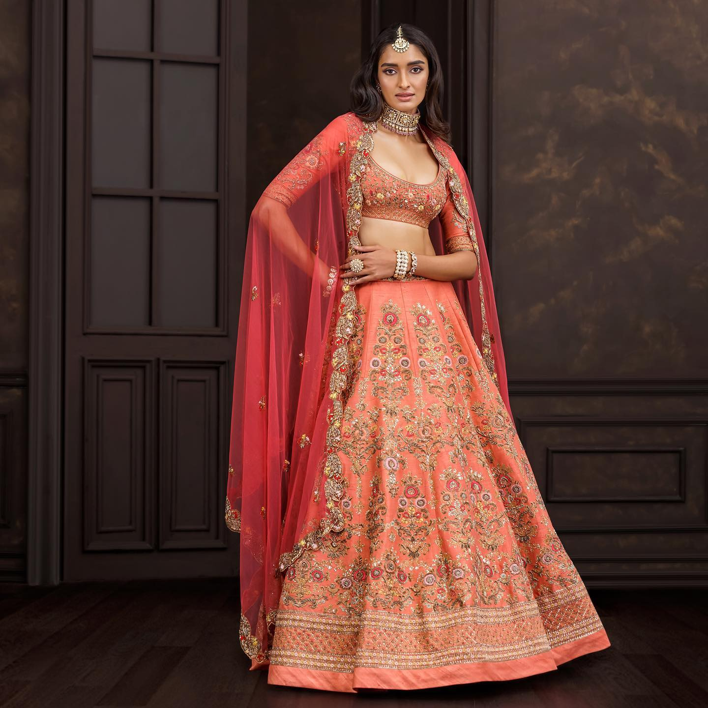 A classic sandstone peach panelled lehenga in raw silk with floral bouquets embroidered in vintage gold zardosi & contrast resham. . Wedding Couture 21-22 Shyamal and Bhumika . Kindly WhatsApp on +91 9833520520 for more information. 2021-10-15