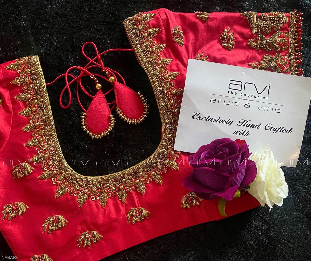 Stunning red color bridal blouse with elephant motifs and baarat hand embroidery bead aari work.  2021-10-15