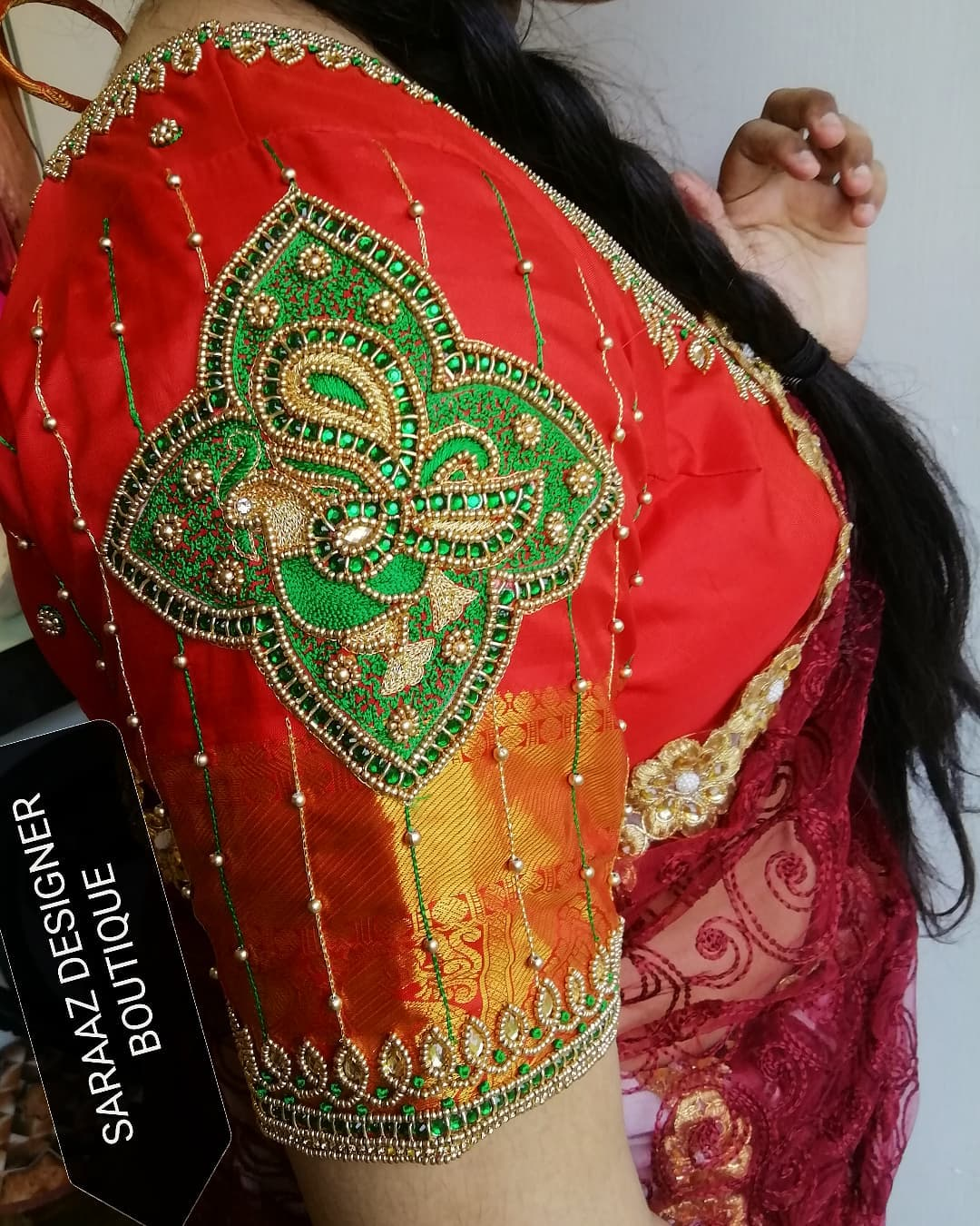 Gorgeous red color bridal blouse with bead and kundan aari work. 2021-10-15