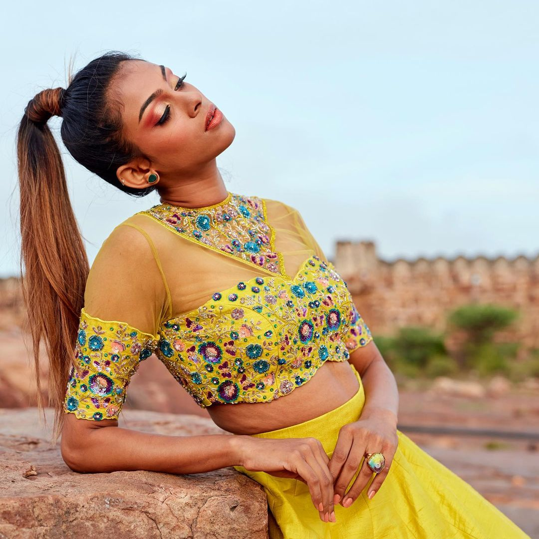 Brand Sruthi Kannath brings to you it's signature choker embroidered blouses in unconventional bold colors this festive season.  A contemporary lehenga ensemble in an offbeat shade of lime with minimal work on ombré-dyed flowers inspired by the cherry blossoms that sure know how to shine. 2021-10-15