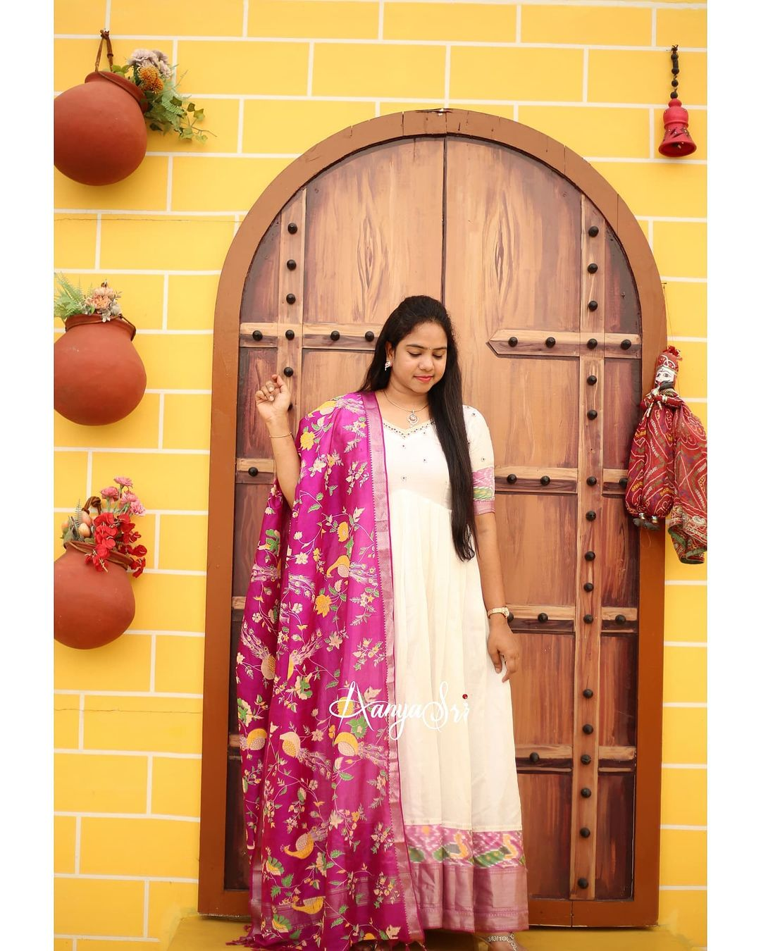 White Mangalagiri hand worked pattu dress with a beautiful contrast pattu printed dupatta. Comes with an ikat border and a traditional khaddi border and intricate silver cutdana handwork on the yoke and reverse v pleats for the yoke . 2021-10-15