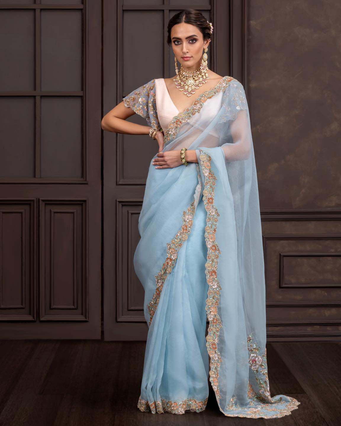 A silk organza saree edged with a vintage gold peeta & sequined border. . Wedding Couture 21-22. Shyamal and Bhumika. 2021-10-16