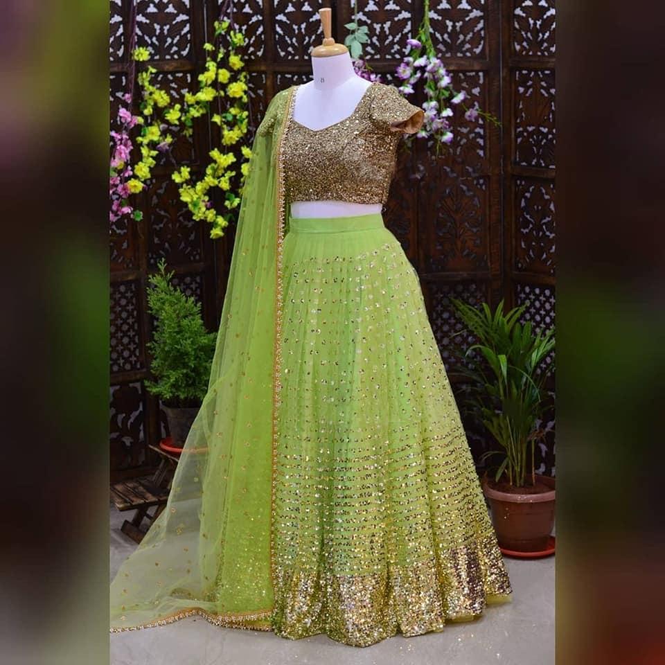 Light green net lehenga with grand sequin blouse. Whatsapp at+918884114148 E-mail:hello@sitarini.com 2021-10-16