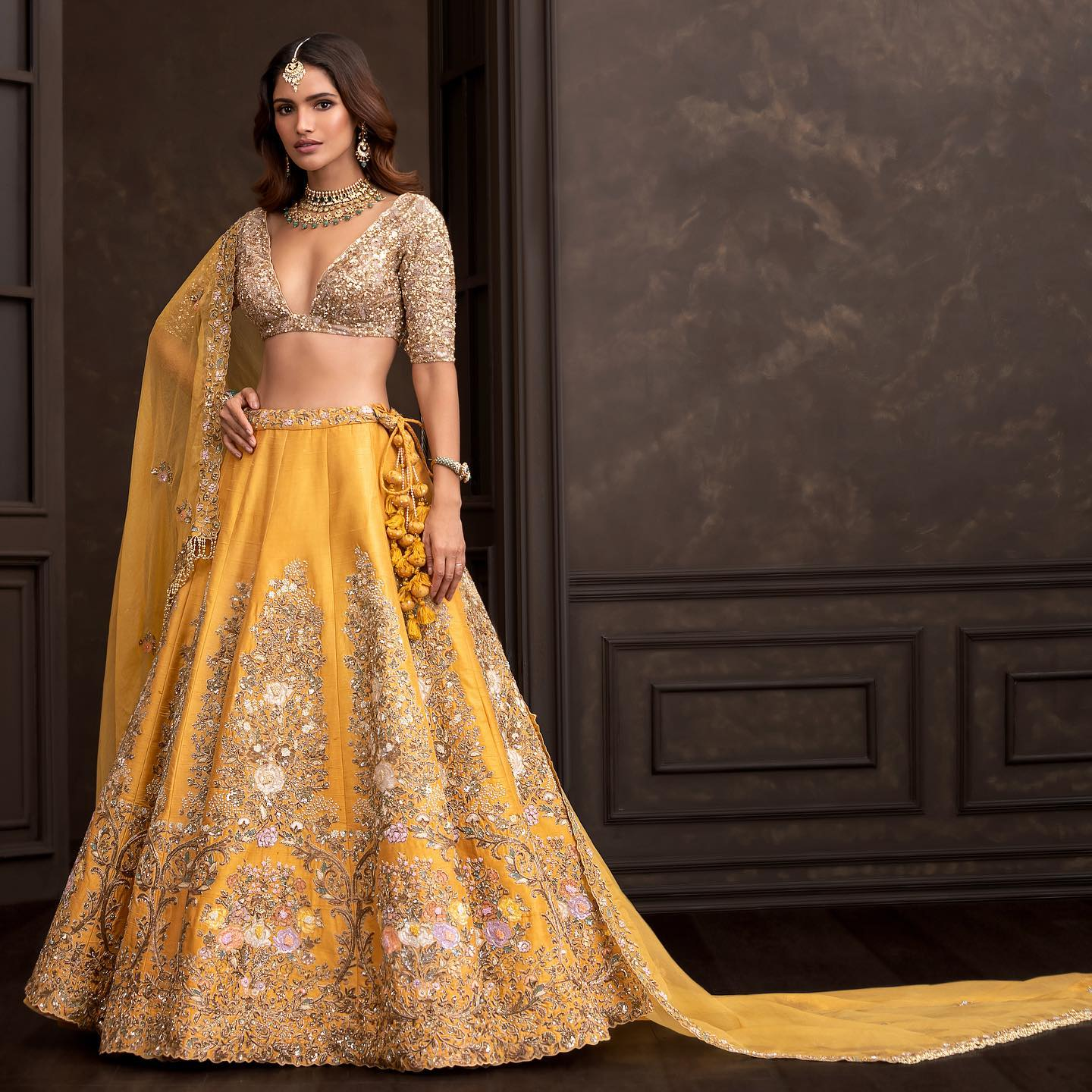 Gorgeous mustard yellow color bridal lehenga and gold sequin blouse  with dupatta. Lehenga with resham hand embroidery work.  2021-10-16