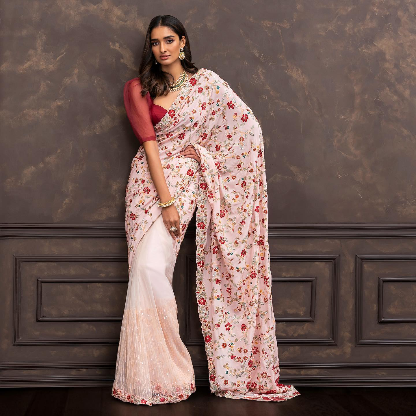 A pale-pink crepe silk saree embroidered in contrast resham and antique finish zari thread. . Wedding Couture 21-22 Shyamal & Bhumika . Kindly WhatsApp us on +91 9833520520 for more information. 2021-10-16