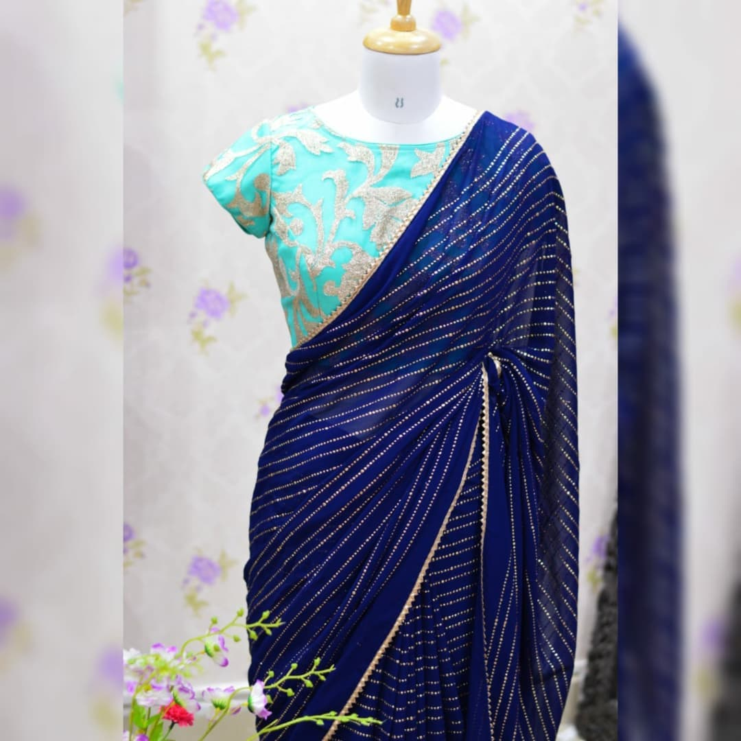 Awesome ..Navi blue pure Georgette saree paired up with nice Teal green jari work blouse.  Blouse sizes can be customized. Collection no:04SHV. For price details inbox  or watsapp on +917799503713  Your price : 3900/- 2021-10-17